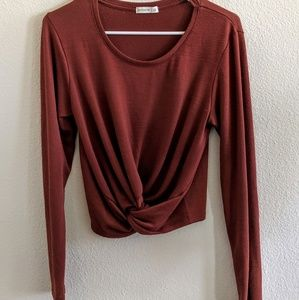 Rustic red long sleeve top with front knot